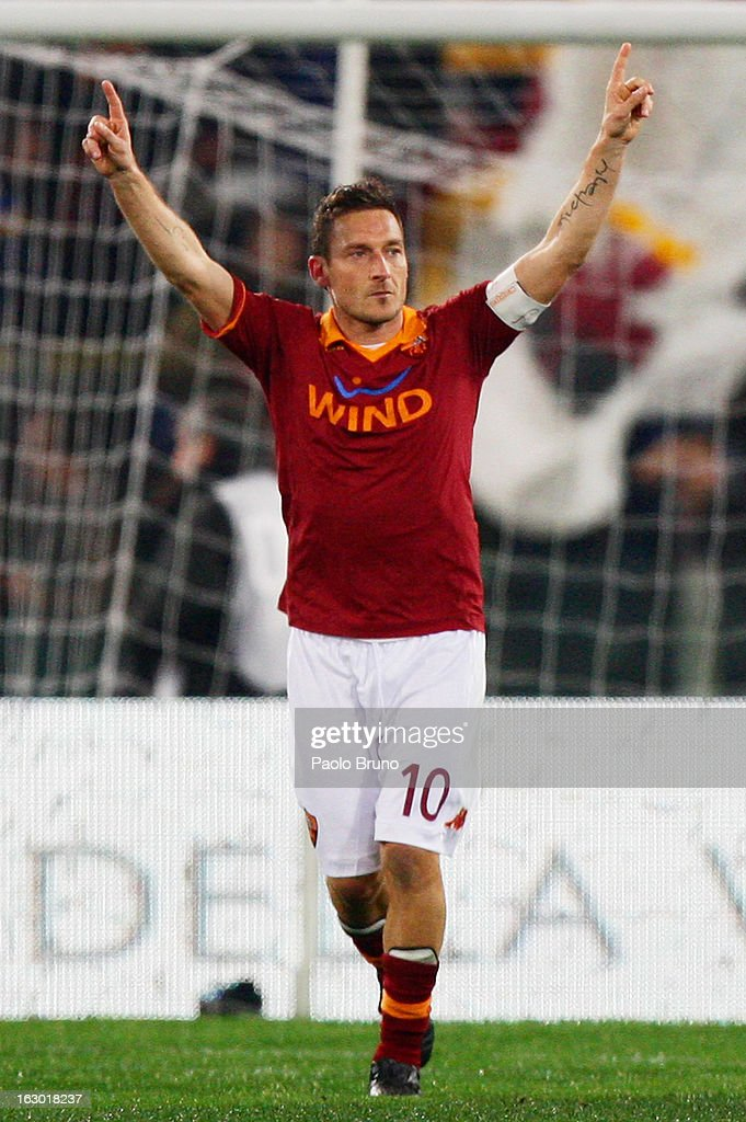 <a gi-track='captionPersonalityLinkClicked' href=/galleries/search?phrase=Francesco+Totti&family=editorial&specificpeople=208985 ng-click='$event.stopPropagation()'>Francesco Totti</a> of AS Roma celebrates after scoring the opening goal from the penalty spot during the Serie A match between AS Roma and Genoa CFC at Stadio Olimpico on March 3, 2013 in Rome, Italy.