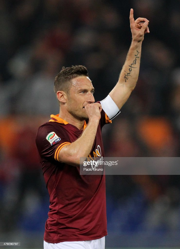<a gi-track='captionPersonalityLinkClicked' href=/galleries/search?phrase=Francesco+Totti&family=editorial&specificpeople=208985 ng-click='$event.stopPropagation()'>Francesco Totti</a> of AS Roma celebrates after scoring the opening goal during the Serie A match between AS Roma and Udinese Calcio at Stadio Olimpico on March 17, 2014 in Rome, Italy.