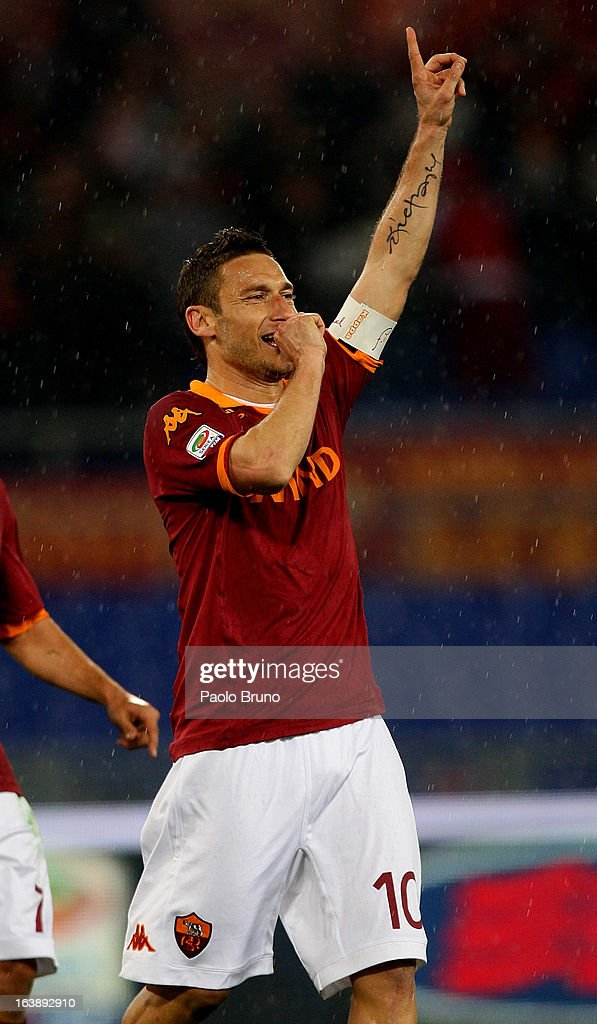 Francesco Totti of AS Roma celebrates after scoring the second team's goal during the Serie A match between AS Roma and Parma FC at Stadio Olimpico on March 17, 2013 in Rome, Italy.