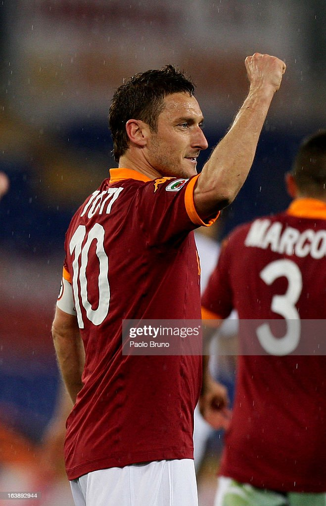 <a gi-track='captionPersonalityLinkClicked' href=/galleries/search?phrase=Francesco+Totti&family=editorial&specificpeople=208985 ng-click='$event.stopPropagation()'>Francesco Totti</a> of AS Roma celebrates after scoring the second team's goal during the Serie A match between AS Roma and Parma FC at Stadio Olimpico on March 17, 2013 in Rome, Italy.
