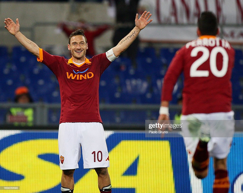 <a gi-track='captionPersonalityLinkClicked' href=/galleries/search?phrase=Francesco+Totti&family=editorial&specificpeople=208985 ng-click='$event.stopPropagation()'>Francesco Totti</a> (L) of AS Roma celebrates after the third team's goal scored by Simone Perrotta during the Serie A match between AS Roma and Genoa CFC at Stadio Olimpico on March 3, 2013 in Rome, Italy.