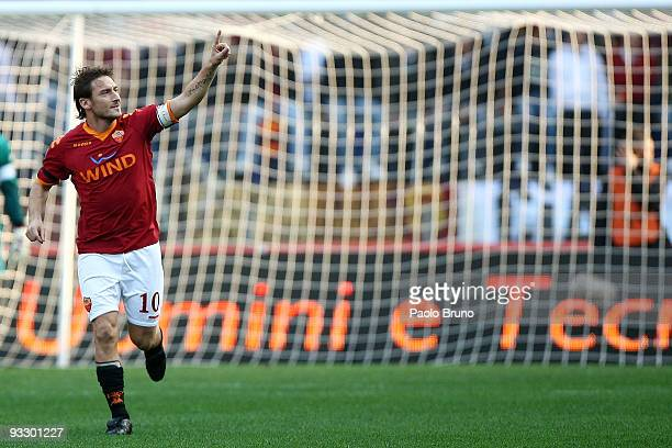 Francesco Totti of AS Roma celebrates scoring his teams opening goal during the Serie A match between Roma and Bari at Stadio Olimpico on November 22...