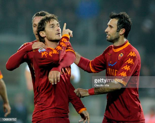 Francesco Totti of AS Roma celebrates scoring the first goal during the Serie A match between Juventus and Roma at Olimpico Stadium on November 13...
