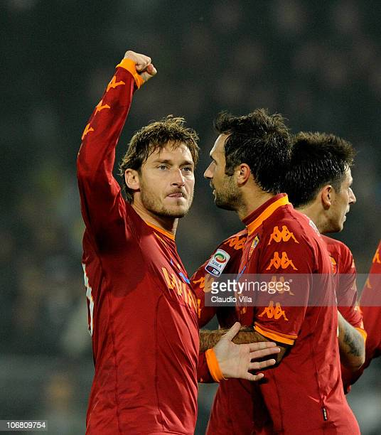 Francesco Totti of AS Roma celebrates with teammates after scoring the 11 equaliser from a penalty during the Serie A match between Juventus and Roma...