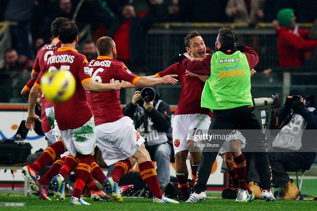 Francesco Totti #10 of AS Roma celebrates with team-mates after scoring the opening goal of the Serie A match between AS Roma and Juventus FC at Stadio Olimpico on February 16, 2013 in Rome, Italy.