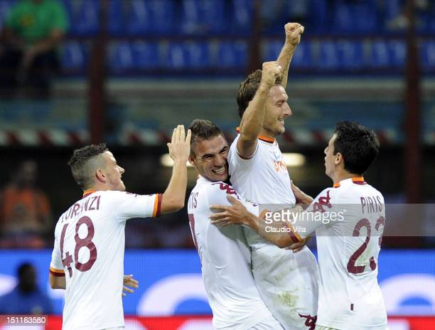 Francesco Totti of AS Roma celebrates with teammates during the Serie A match between FC Internazionale Milano and AS Roma at San Siro Stadium on...