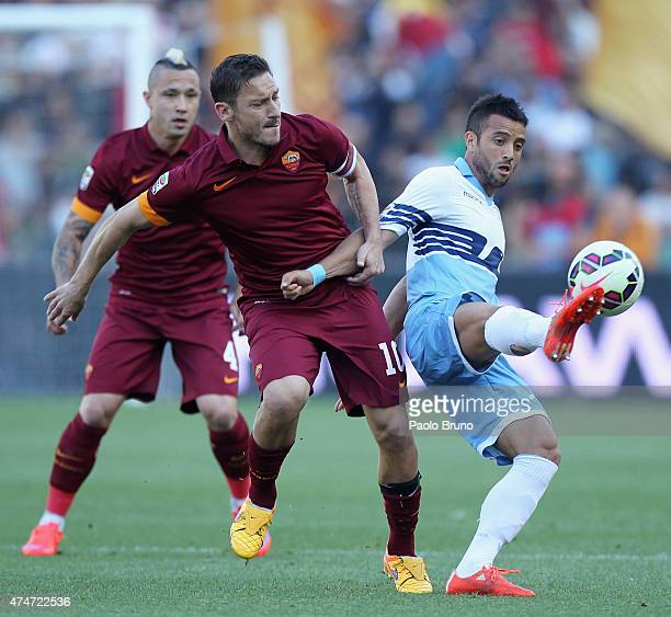 Francesco Totti of AS Roma competes for the ball with Felipe Anderson of SS Lazio during the Serie A match between SS Lazio and AS Roma at Stadio...