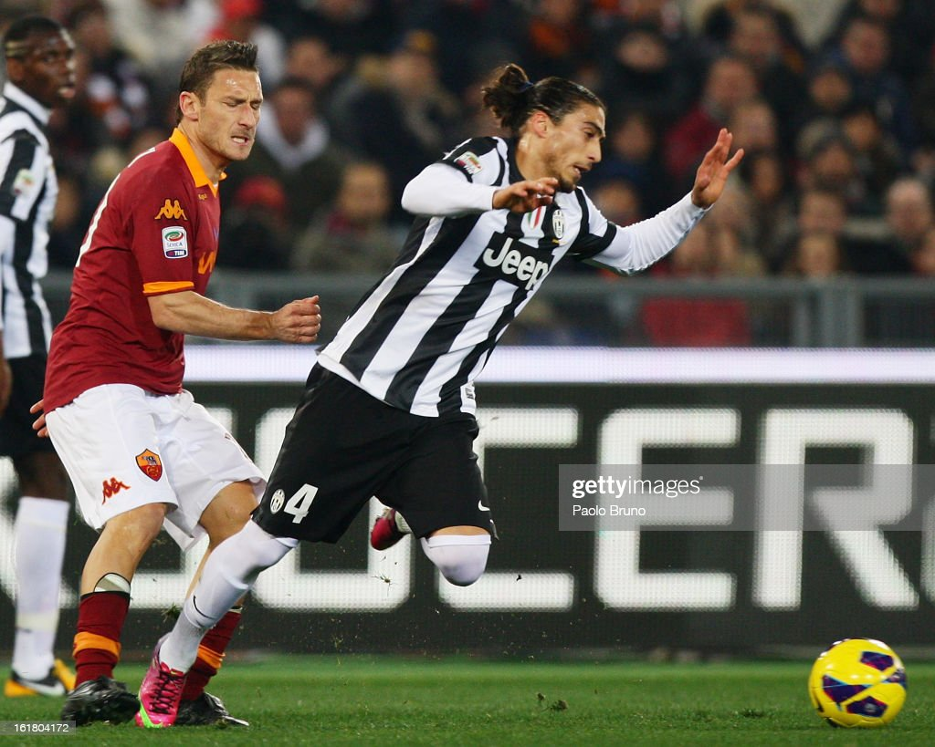 <a gi-track='captionPersonalityLinkClicked' href=/galleries/search?phrase=Francesco+Totti&family=editorial&specificpeople=208985 ng-click='$event.stopPropagation()'>Francesco Totti</a> (L) of AS Roma competes for the ball with Martin Caceres of Juventus FC during the Serie A match between AS Roma and Juventus FC at Stadio Olimpico on February 16, 2013 in Rome, Italy.