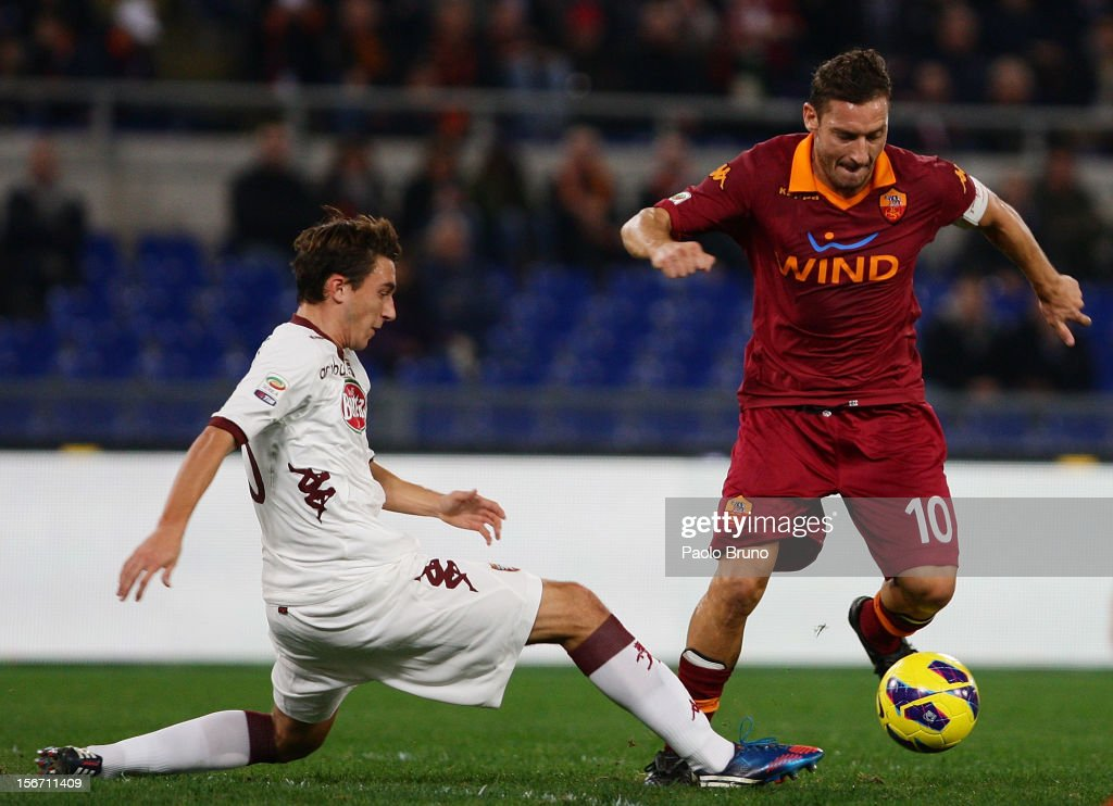 <a gi-track='captionPersonalityLinkClicked' href=/galleries/search?phrase=Francesco+Totti&family=editorial&specificpeople=208985 ng-click='$event.stopPropagation()'>Francesco Totti</a> (R) of AS Roma competes for the ball with Matteo Darmian of Torino FC during the Serie A match between AS Roma and Torino FC at Stadio Olimpico on November 19, 2012 in Rome, Italy.