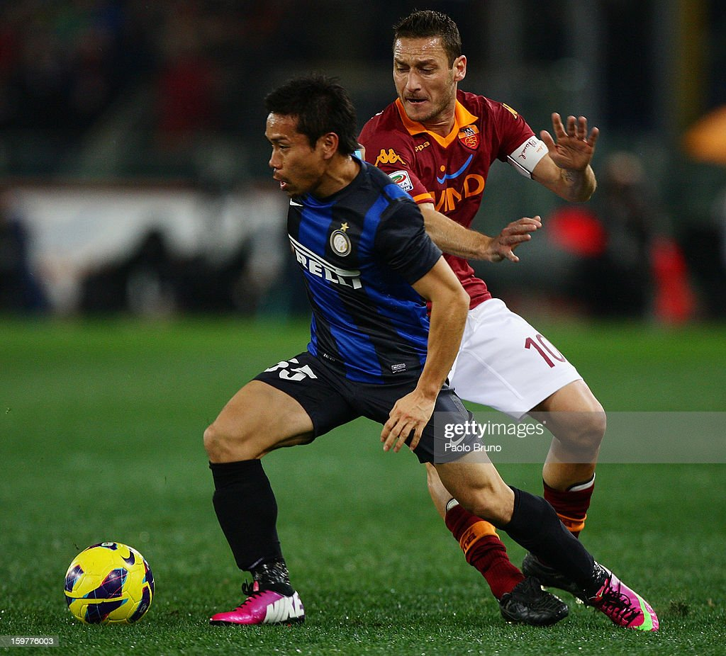 <a gi-track='captionPersonalityLinkClicked' href=/galleries/search?phrase=Francesco+Totti&family=editorial&specificpeople=208985 ng-click='$event.stopPropagation()'>Francesco Totti</a> (R) of AS Roma competes for the ball with <a gi-track='captionPersonalityLinkClicked' href=/galleries/search?phrase=Yuto+Nagatomo&family=editorial&specificpeople=4320811 ng-click='$event.stopPropagation()'>Yuto Nagatomo</a> of FC Internazionale Milano during the Serie A match between AS Roma and FC Internazionale Milano at Stadio Olimpico on January 20, 2013 in Rome, Italy.