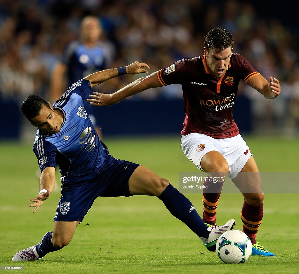Francesco Totti of AS Roma controls the ball as Tony Beltran of the MLS AllStars defends during the 2013 Major League Soccer All Star Game at...