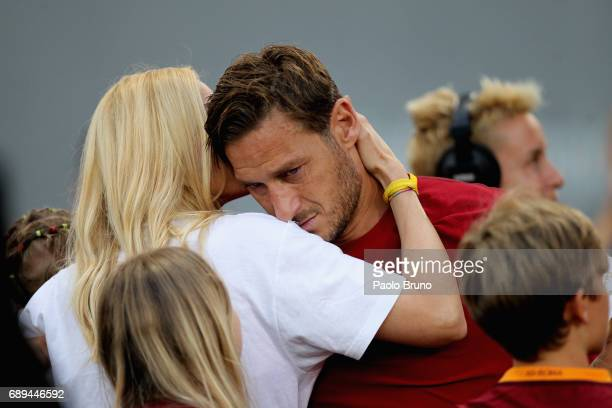Francesco Totti of AS Roma cries after his last match with his wife Ilary Blasi after the Serie A match between AS Roma and Genoa CFC at Stadio...