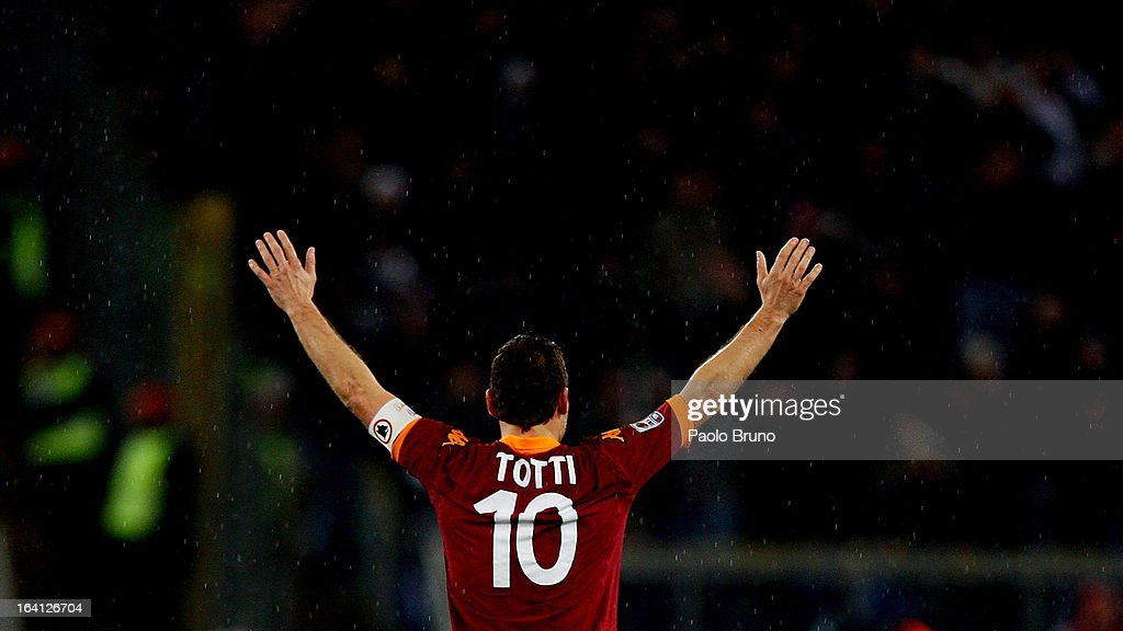 Francesco Totti of AS Roma greets his fans seen from behind during the Serie A match between AS Roma and Parma FC at Stadio Olimpico on March 17, 2013 in Rome, Italy.