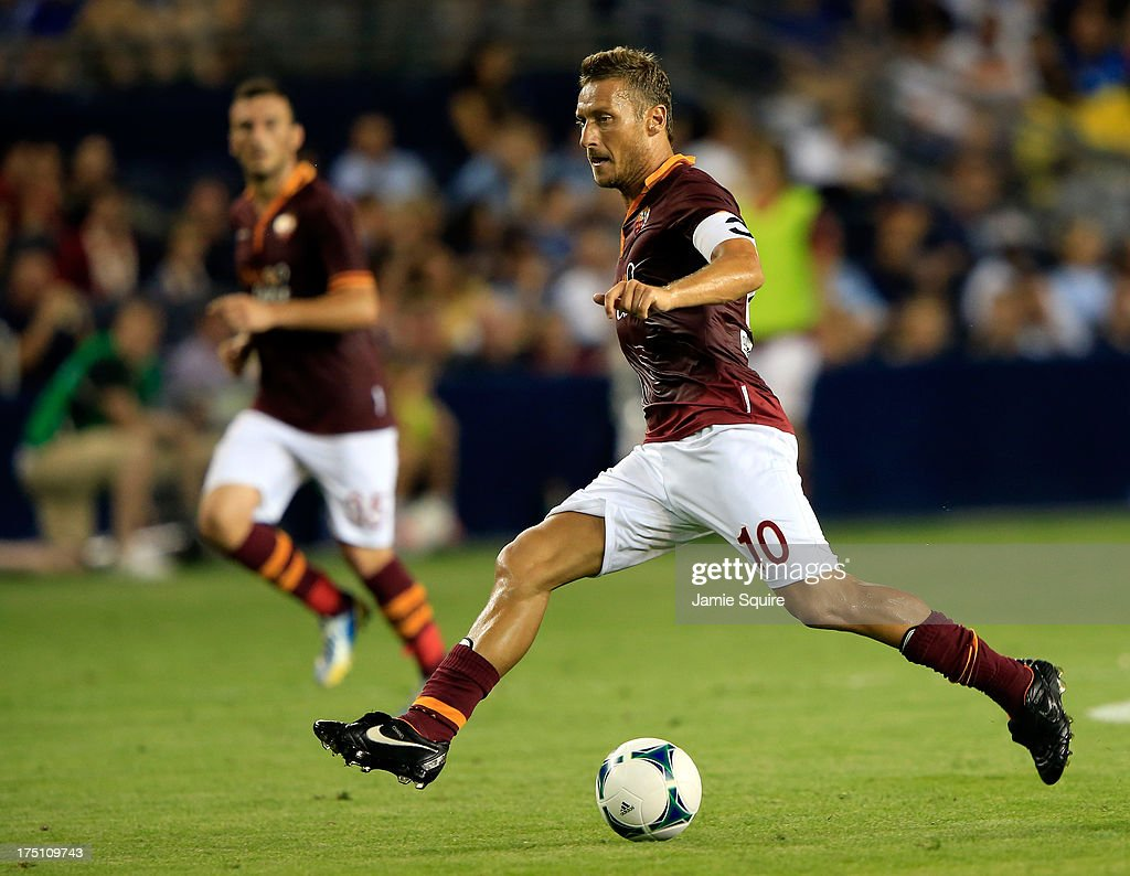 <a gi-track='captionPersonalityLinkClicked' href=/galleries/search?phrase=Francesco+Totti&family=editorial&specificpeople=208985 ng-click='$event.stopPropagation()'>Francesco Totti</a> #10 of AS Roma in action during the 2013 Major League Soccer All Star Game against the MLS All-Stars at Sporting Park on July 31, 2013 in Kansas City, Kansas.