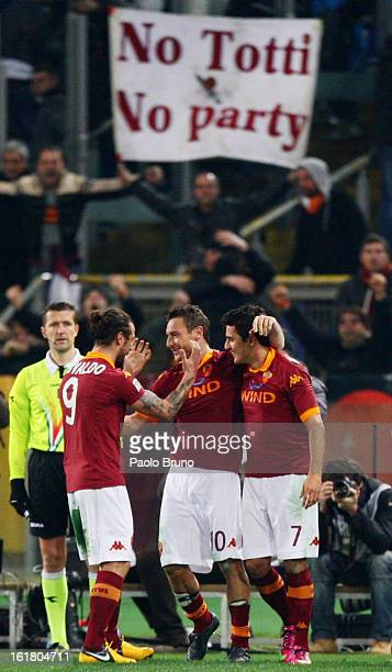 Francesco Totti of AS Roma is congratulated by teammates after scoring the opening goal of the Serie A match between AS Roma and Juventus FC at...