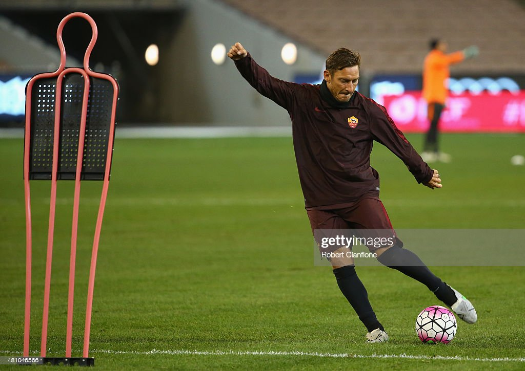 Francesco Totti of AS Roma kicks the ball during an AS Roma training session at Melbourne Cricket Ground on July 17 2015 in Melbourne Australia