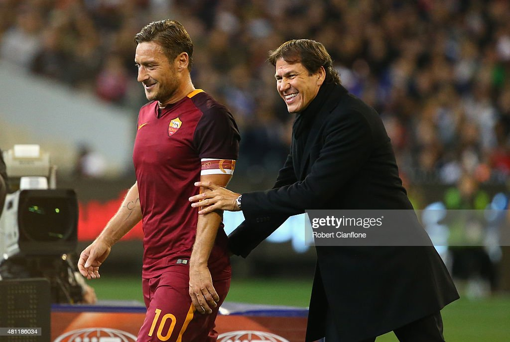 <a gi-track='captionPersonalityLinkClicked' href=/galleries/search?phrase=Francesco+Totti&family=editorial&specificpeople=208985 ng-click='$event.stopPropagation()'>Francesco Totti</a> of AS Roma laughs with AS Roma coach <a gi-track='captionPersonalityLinkClicked' href=/galleries/search?phrase=Rudi+Garcia&family=editorial&specificpeople=4444731 ng-click='$event.stopPropagation()'>Rudi Garcia</a> after he was substituted during the International Champions Cup friendly match between Real Madrid and AS Roma at the Melbourne Cricket Ground on July 18, 2015 in Melbourne, Australia.