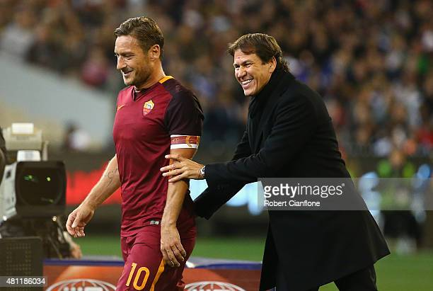 Francesco Totti of AS Roma laughs with AS Roma coach Rudi Garcia after he was substituted during the International Champions Cup friendly match...