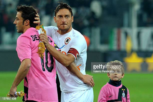 Francesco Totti of AS Roma salutes Alessandro Del Piero of Juventus FC prior to the Tim Cup match between Juventus FC and AS Roma at Juventus Arena...