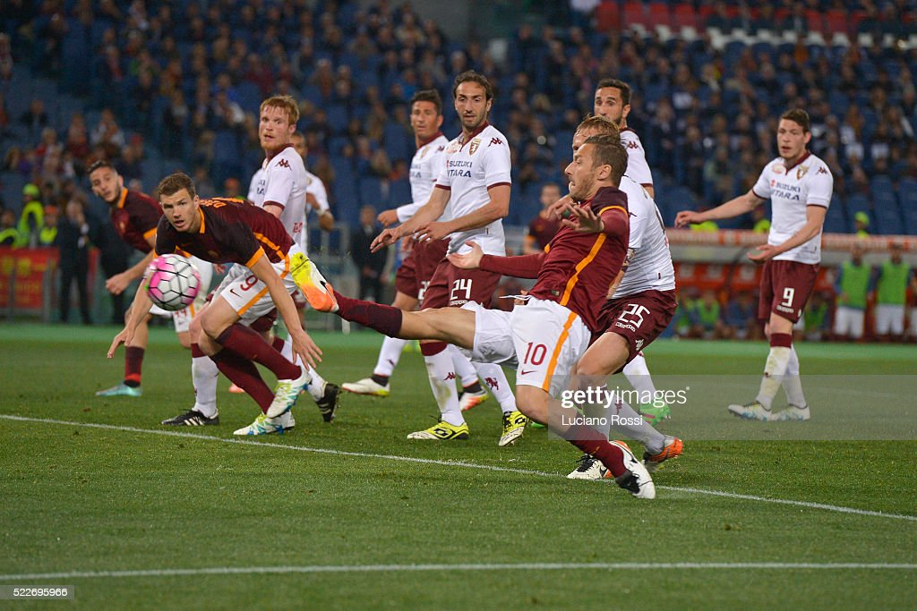 <a gi-track='captionPersonalityLinkClicked' href=/galleries/search?phrase=Francesco+Totti&family=editorial&specificpeople=208985 ng-click='$event.stopPropagation()'>Francesco Totti</a> of AS Roma scores his first goal during the Serie A match between AS Roma and Torino FC at Stadio Olimpico on April 20, 2016 in Rome, Italy.