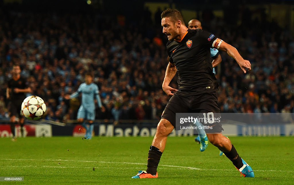 Francesco Totti of AS Roma scores his team's first goal during the UEFA Champions League Group E match between Manchester City FC and AS Roma on September 30, 2014 in Manchester, United Kingdom.