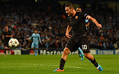 Francesco Totti of AS Roma scores his team's first goal during the UEFA Champions League Group E match between Manchester City FC and AS Roma on...