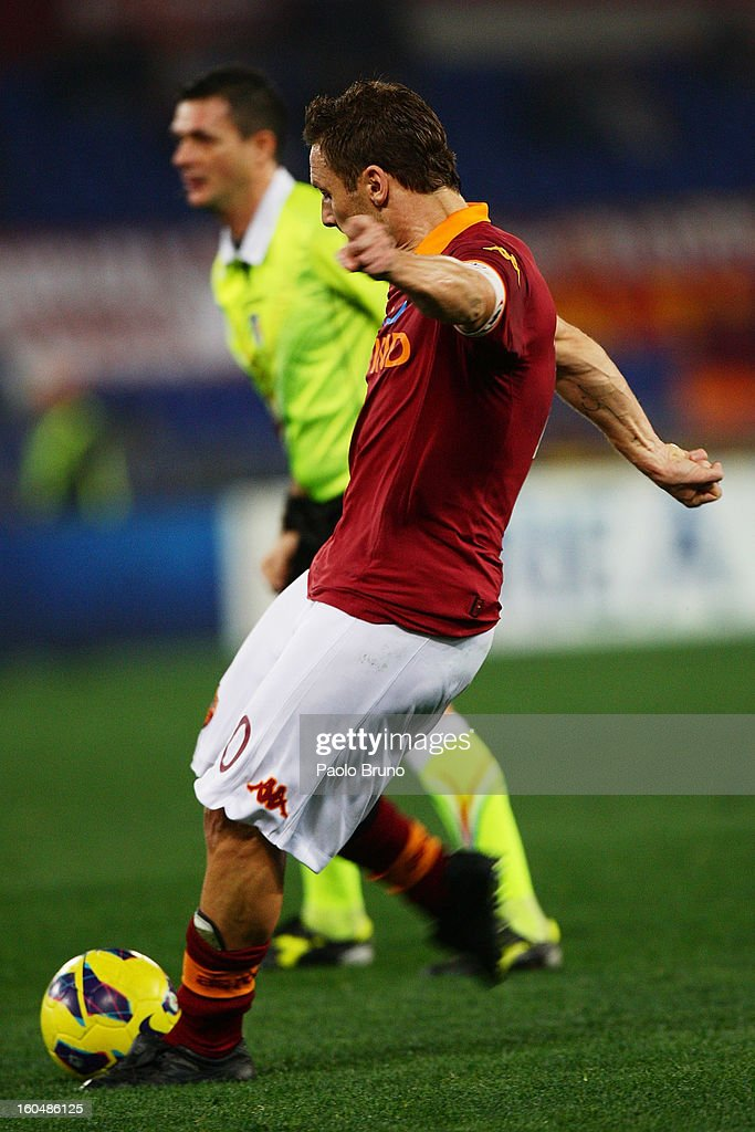 Francesco Totti of AS Roma scores the first team's goal during the Serie A match between AS Roma and Cagliari Calcio at Stadio Olimpico on February 1, 2013 in Rome, Italy.