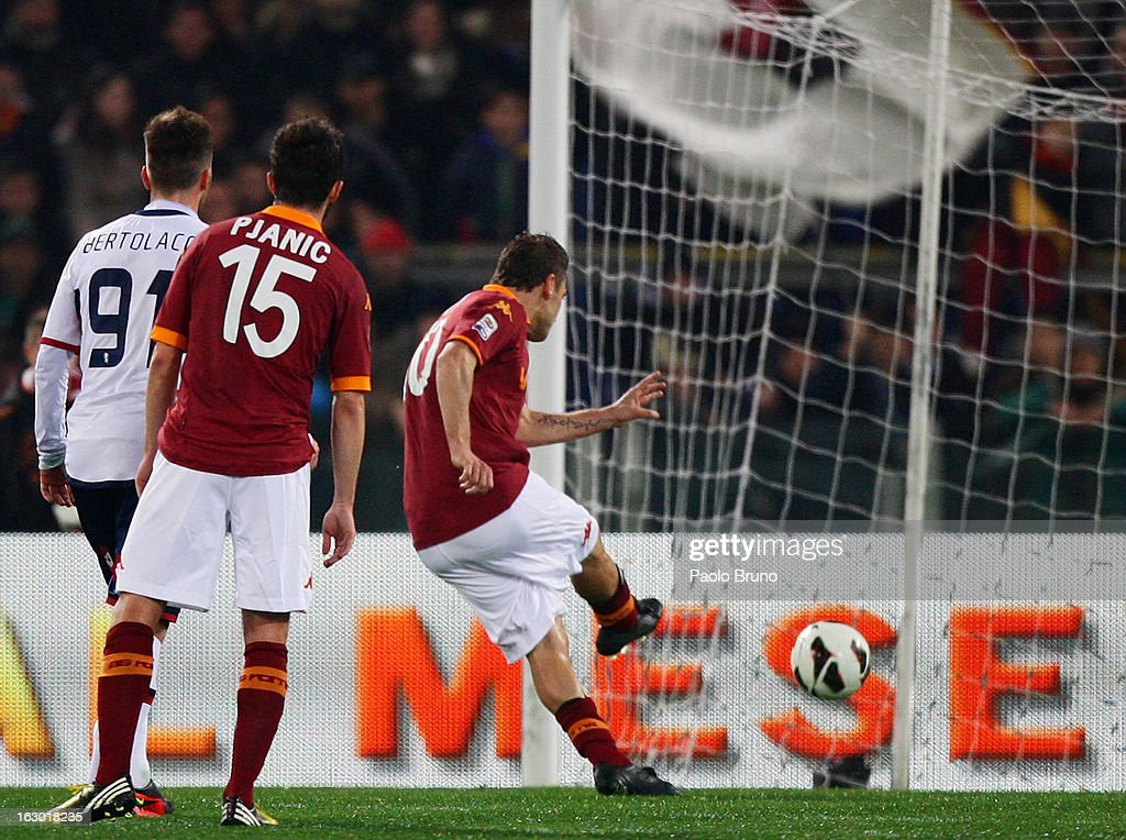 <a gi-track='captionPersonalityLinkClicked' href=/galleries/search?phrase=Francesco+Totti&family=editorial&specificpeople=208985 ng-click='$event.stopPropagation()'>Francesco Totti</a> (R) of AS Roma scores the opening goal from the penalty spot during the Serie A match between AS Roma and Genoa CFC at Stadio Olimpico on March 3, 2013 in Rome, Italy.