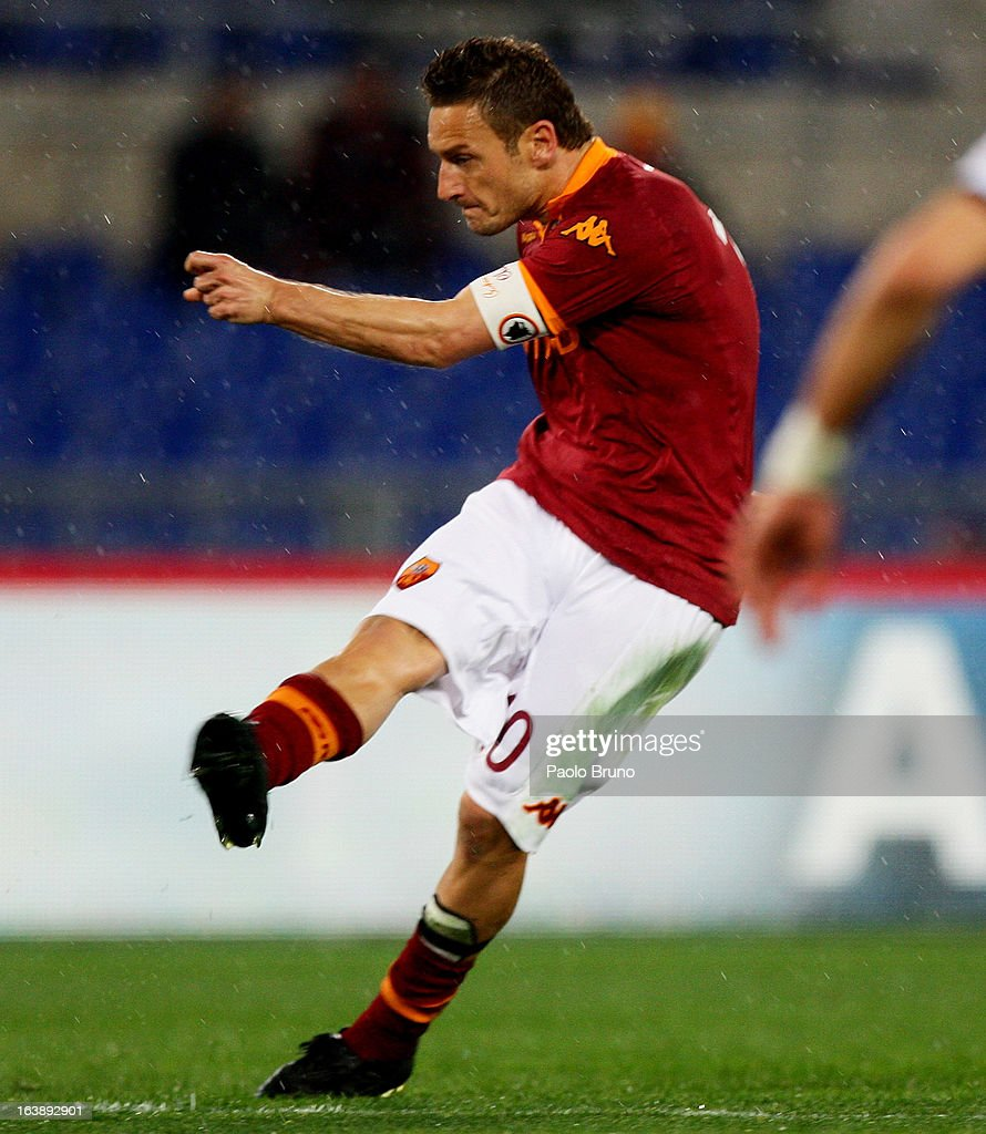 Francesco Totti of AS Roma scores the second team's goal during the Serie A match between AS Roma and Parma FC at Stadio Olimpico on March 17, 2013 in Rome, Italy.