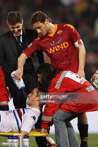Francesco Totti of AS Roma throws the water to Reto Ziegler of UC Sampdoria during the Serie A match between AS Roma and UC Sampdoria at Stadio...