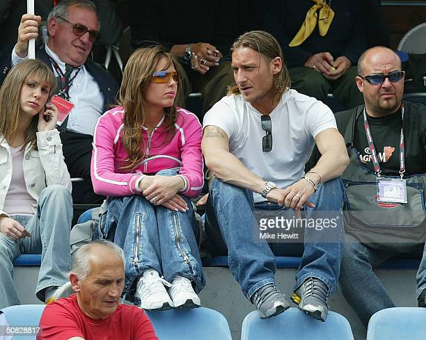 Francesco Totti of Italy and girlfriend Ilary Blasi attend the Women's Telecom Italia Tennis Masters on May 12 2004 at the Foro Italico in Rome Italy