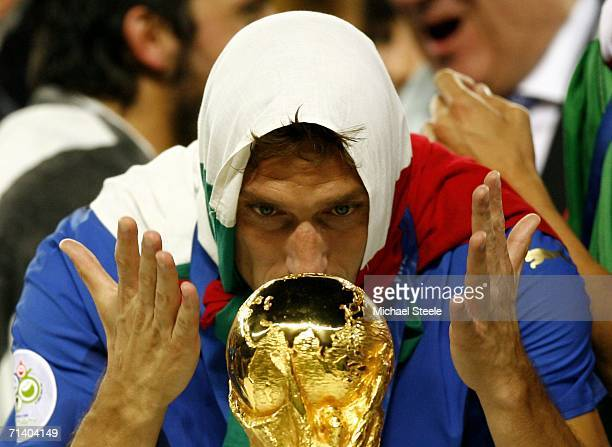 Francesco Totti of Italy celebrates with the world cup trophy following his team's victory during the FIFA World Cup Germany 2006 Final match between...