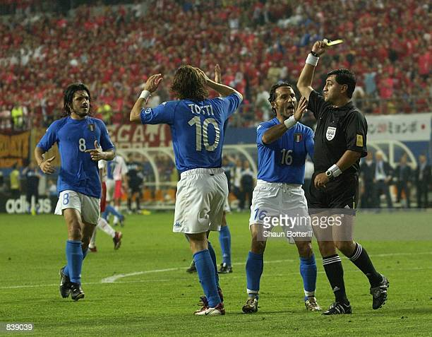 Francesco Totti of Italy is shown his second yellow card for diving by referee Byron Moreno of Ecuador during the FIFA World Cup Finals 2002 Second...