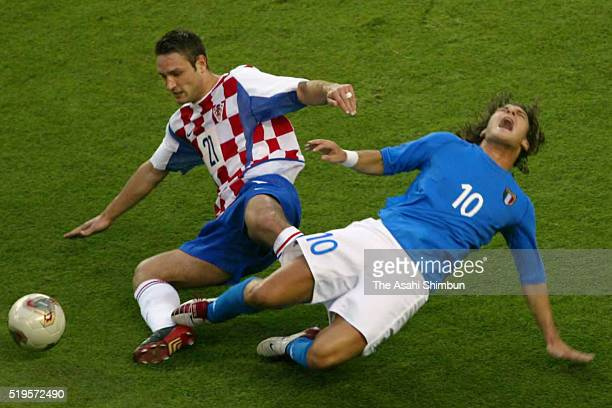 Francesco Totti of Italy is tackled by Robert Kovac of Croatia during the FIFA World Cup Korea/Japan Group G match between Italy and Croatia at...