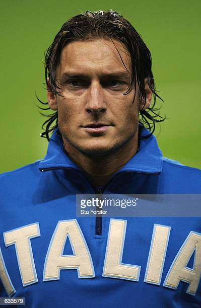 Francesco Totti of Italy lines up for the national anthems before the Group G match against Ecuador at the Group Stages of the World Cup played at...