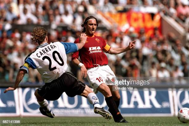 Francesco Totti of Roma and Massimo Carrera of Atalantacompete for the ball during the SERIE A 30th Round League match between Roma and Atalanta...