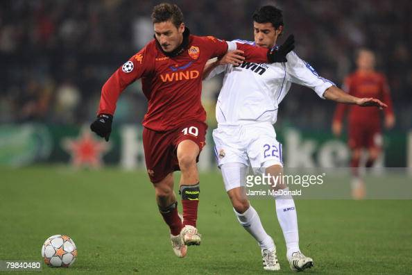 Francesco Totti of Roma battles with Miguel Torres of Madrid during the UEFA Champions League first knockout round first leg match between AS Roma...