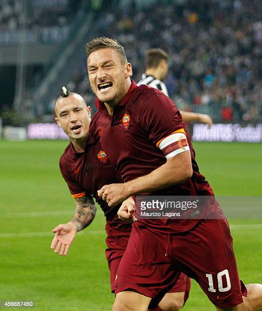 Francesco Totti of Roma celebrates after scoring his team's equalizing goal during the Serie A match between Juventus FC and AS Roma at Juventus...