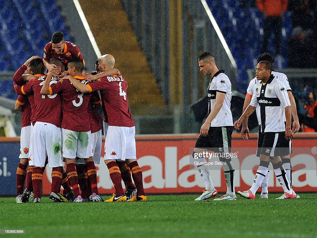 <a gi-track='captionPersonalityLinkClicked' href=/galleries/search?phrase=Francesco+Totti&family=editorial&specificpeople=208985 ng-click='$event.stopPropagation()'>Francesco Totti</a> of Roma celebrates after scoring the goal 2-0 during the Serie A match between AS Roma and Parma FC at Stadio Olimpico on March 17, 2013 in Rome, Italy.