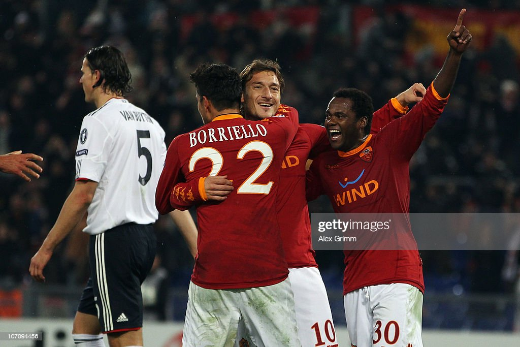 Francesco Totti (2R) of Roma celebrates his team's third goal with team mates Marco Borriello (2L) and Fabio Simplicio (R) as Daniel van Buyten (L) of Muenchen reacts during the UEFA Champions League group E match between AS Roma and FC Bayern Muenchen at Stadio Olimpico on November 23, 2010 in Rome, Italy.