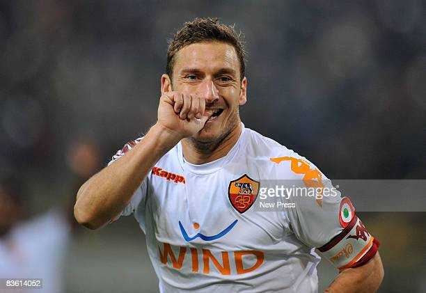 Francesco Totti of Roma celebrates scoring a goal during the Serie A match between Bologna and Roma at the Stadio Dall'Ara on November 08 2008 in...