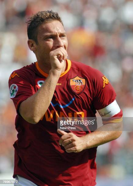 Francesco Totti of Roma celebrates scoring during the Serie A match between Roma and Juventus at the Stadio Olimpico on September 23 in Roma Italy