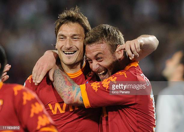 Francesco Totti of Roma celebrates with teams mates Daniele De Rossi after scoring his opening penalty goal during the Serie A match between Udinese...