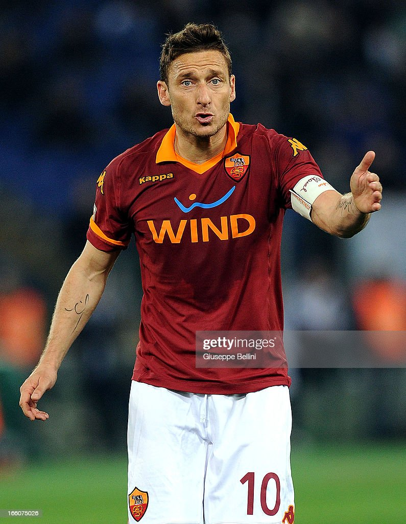 <a gi-track='captionPersonalityLinkClicked' href=/galleries/search?phrase=Francesco+Totti&family=editorial&specificpeople=208985 ng-click='$event.stopPropagation()'>Francesco Totti</a> of Roma during the Serie A match between AS Roma and S.S. Lazio at Stadio Olimpico on April 8, 2013 in Rome, Italy.