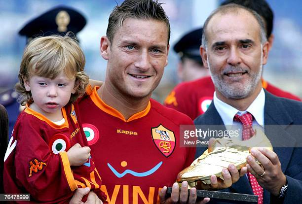 Francesco Totti of Roma holding his son Cristian as he receives the 'Golden Shoe 2007' award as best player of the Italian premier league during a...