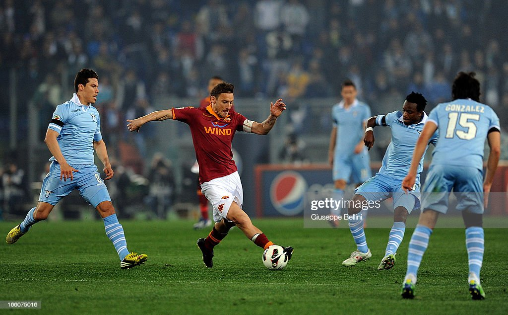 <a gi-track='captionPersonalityLinkClicked' href=/galleries/search?phrase=Francesco+Totti&family=editorial&specificpeople=208985 ng-click='$event.stopPropagation()'>Francesco Totti</a> of Roma in action during the Serie A match between AS Roma and S.S. Lazio at Stadio Olimpico on April 8, 2013 in Rome, Italy.