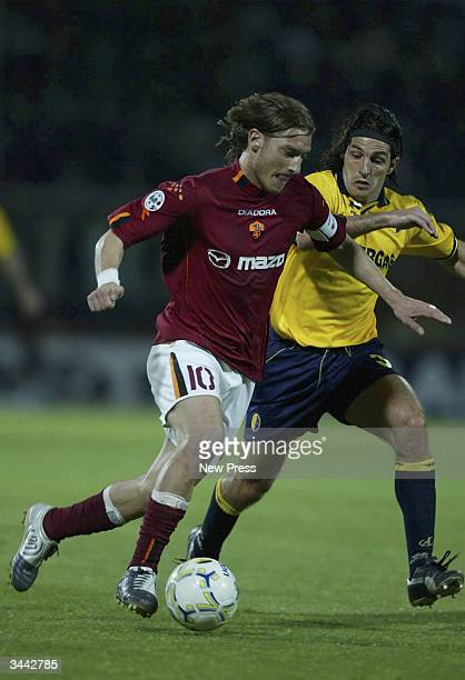 Francesco Totti of Roma is challenged by Jacopo Balestri of Modena during the Seria A match between Modena and AS Roma at the Alberto Braglia stadium...