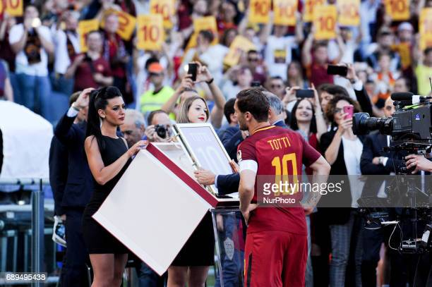 Francesco Totti of Roma receives a special prize from James Pallotta the owner of AS Roma after his last appearance in Rome after more than 20 years...