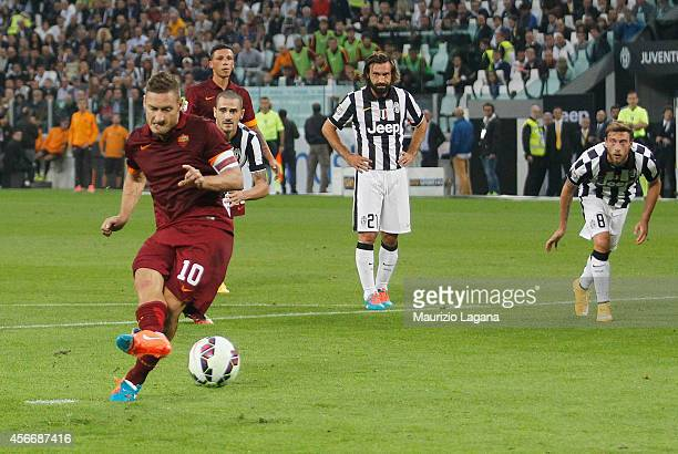 Francesco Totti of Roma scores his team's equalizing goal with penalty during the Serie A match between Juventus FC and AS Roma at Juventus Arena on...