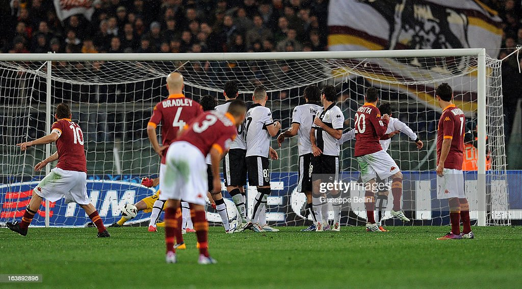 Francesco Totti of Roma scores the goal 2-0 during the Serie A match between AS Roma and Parma FC at Stadio Olimpico on March 17, 2013 in Rome, Italy.
